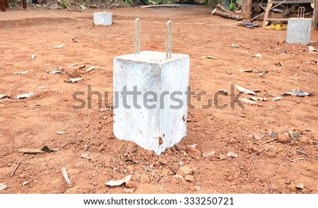 Concrete pillars base for the structure of the house - stock photo