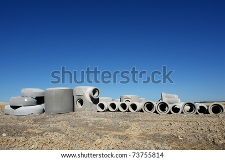 concrete pipes on a building site on a sunny day - stock photo