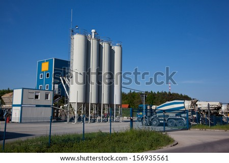 Concrete producing plant with industrial silos - stock photo