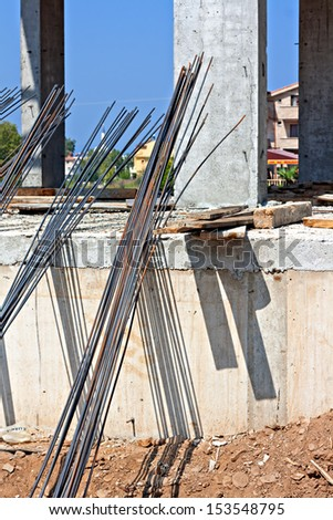 Concrete reinforcing rods on construction site - stock photo