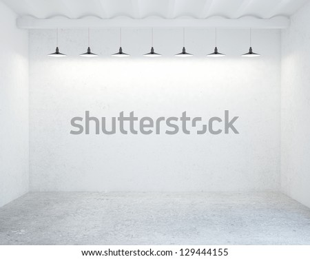concrete room with ceiling lamps - stock photo