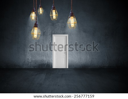 concrete room with closed door - stock photo