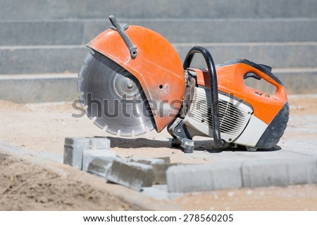 Concrete saw tool equipment at construction site - stock photo