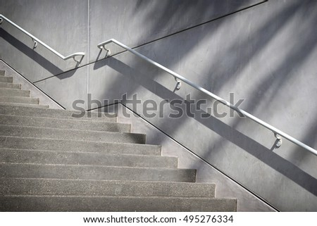 Concrete Stairs And Handrail With Shadows Forming Abstract Design