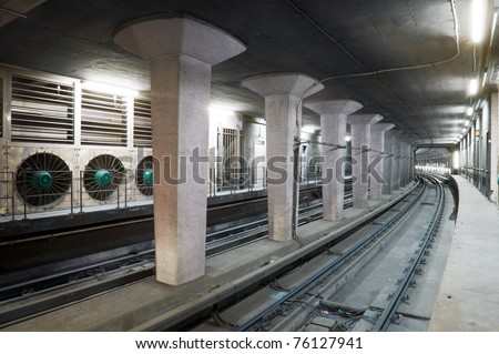 Concrete subway tunnel, with a set of huge ventilator for safety reasons - stock photo