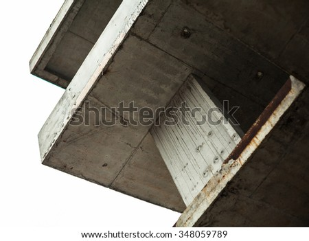 Concrete surfaces of the unfinished building against the white sky - stock photo