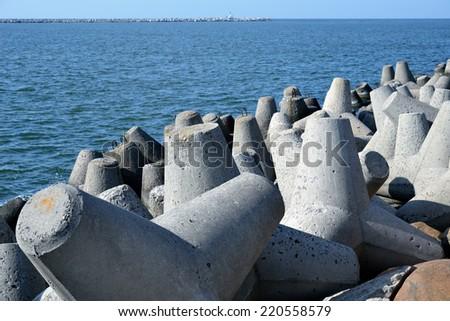 Concrete tetrapods at the sea coast - stock photo