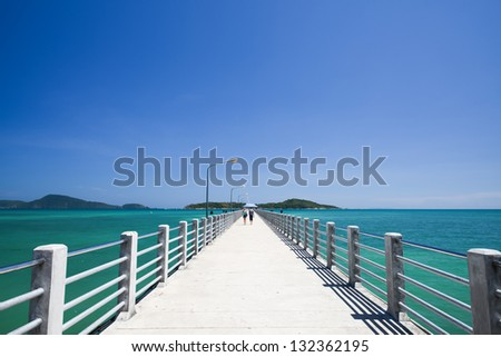 Concrete walk bridge across the sea with the blue sky at rawai beach, phuket Thailand