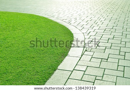 Concrete walkway in the park. - stock photo