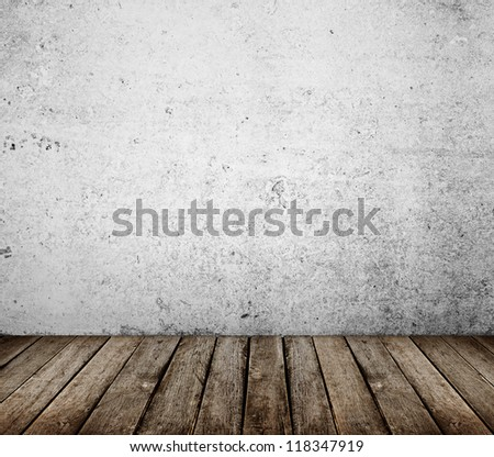 concrete wall and brown wood floor - stock photo