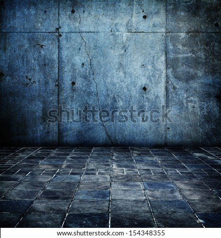 Concrete wall and floor in blue tone. - stock photo