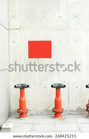 Concrete wall and floor with fire hydrant. - stock photo