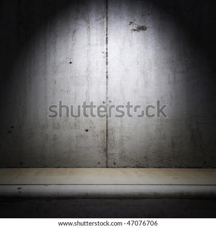 Concrete wall and  floor with top light - stock photo