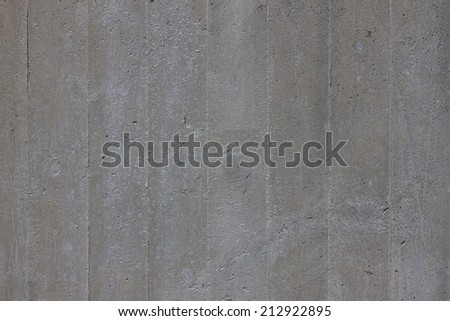 concrete wall background of an industrial building - stock photo