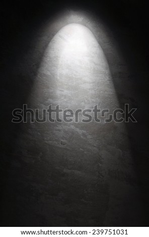 Concrete wall illuminated by a real spotlight - stock photo