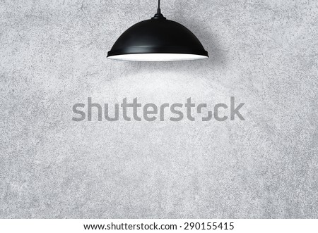 Concrete wall illuminated by the lamp with copy space - stock photo
