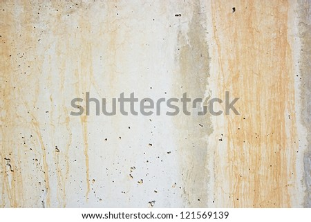 Concrete wall texture in rough, grunge style with stains and wear - stock photo
