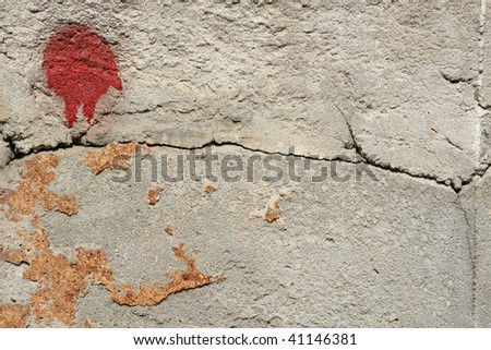 concrete wall with red spot