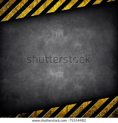 concrete wall with warning stripe - stock photo