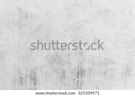 Concrete wall with whitewash layer, background photo texture - stock photo