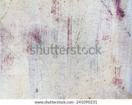 Concrete, weathered, worn, painted in white and purple. Landscape style. Grungy concrete surface. Great background or texture. - stock photo