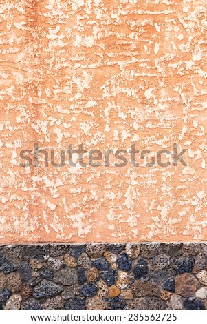 Concrete, weathered, worn walls lined with natural stone. Grungy Concrete Surface. Great background or texture.  - stock photo