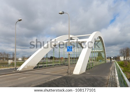 concrete white arch bridge in Enschede, Netherlands - stock photo