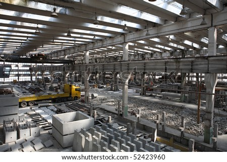 Concrete works in factory. Storage area in shop - stock photo