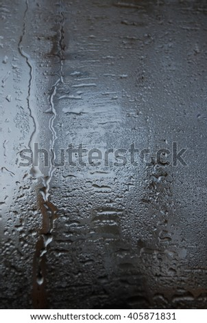 Condensation forms on the glass from the temperature difference of a window. Background.