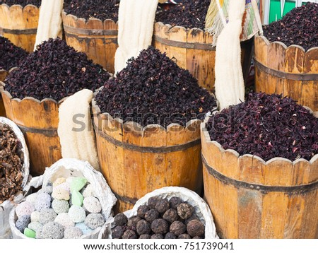 Condiment and ingredient concept. Dry herb hibiscus for tea in baskets. Arabic herbs on traditional bazaar. Natural organic herbs.