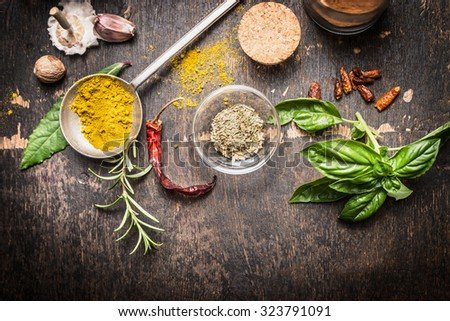 Condiments and spices for creative cooking on dark rustic wooden background, top view, banner - stock photo