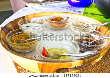 Condiments sauces on the wood plate - stock photo