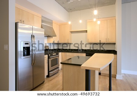 Condo Apartment Contemporary Kitchen. Granite counters, stainless steel appliances - stock photo