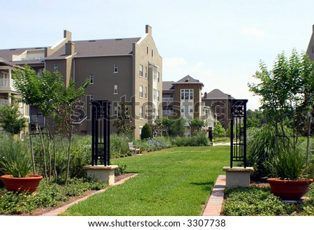 Condo buildings with spring bloom in the park - stock photo