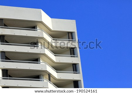 Condo in South Florida with stacked hurricane shutters for protection - stock photo
