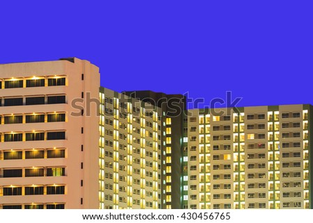 Condo Windows At Night Background - stock photo