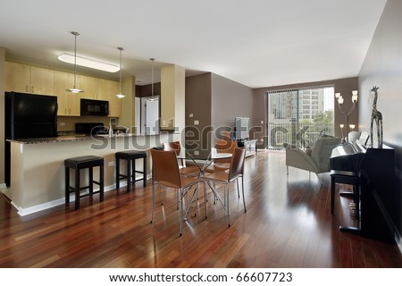 Condo with open floor plan and granite kitchen counter top - stock photo