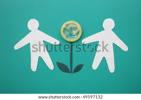 Condom and paper people. - stock photo
