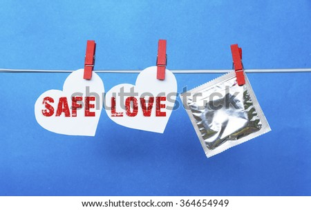condom and  white heart, colorful wooden clothespin. space for text information. valentine days, dating, making love concept - SAFE LOVE - stock photo