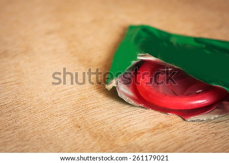 condom on wooden table background.soft and selective focus.  - stock photo