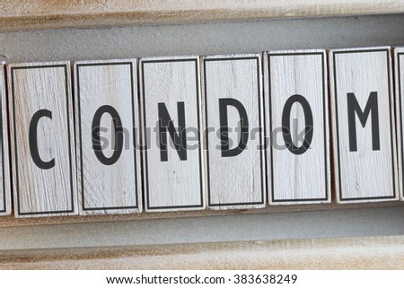 CONDOM word on wood blocks concept - stock photo