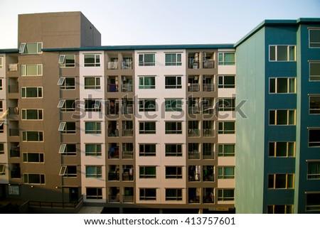 Condominium residential block building in evening - stock photo