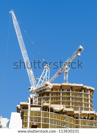 Condominium tower under construction with crane