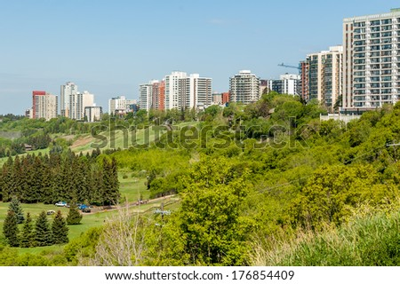 Condominium towers in Edmonton along the beautiful Saskatchewan River valley. - stock photo