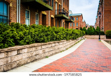 Condominiums along the Waterfront Promenade in Fells Point, Baltimore, Maryland. - stock photo