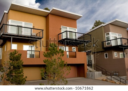 condominiums for sale or rent with blue skies - stock photo