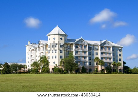 Condominiums With Castle Tower Appearance With Deep Blue Sky Right After Sunrise - stock photo