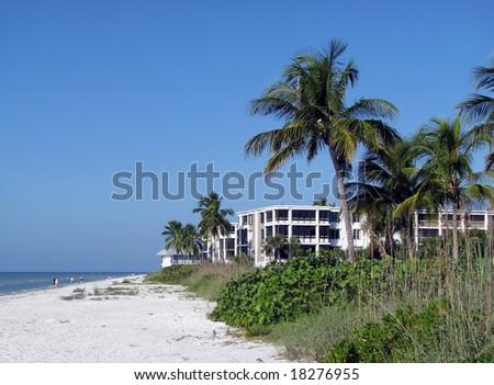 condos on a beautiful Florida beach shoreline - stock photo