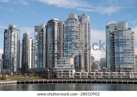 Condos on the water front on a nice sunny day.Vancouver, British Columbia - stock photo