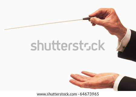 Conductor conducting an orchestra isolated on white background with copy area - stock photo